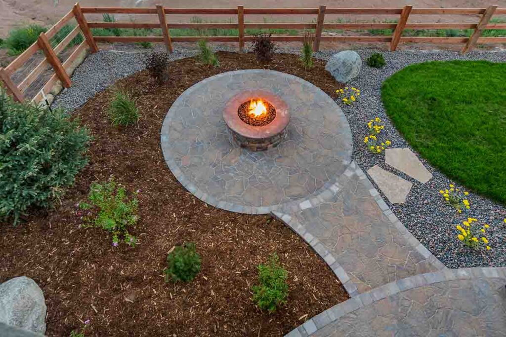 Circular Gas Fire Pit in back of house