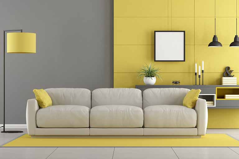Living room with yellow wall and beige couch